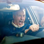 Angry man driving