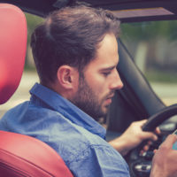 Guy texting while driving.jpg.crdownload