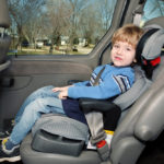 Child strapped to car seat