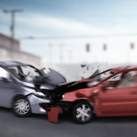Grey and red car crash